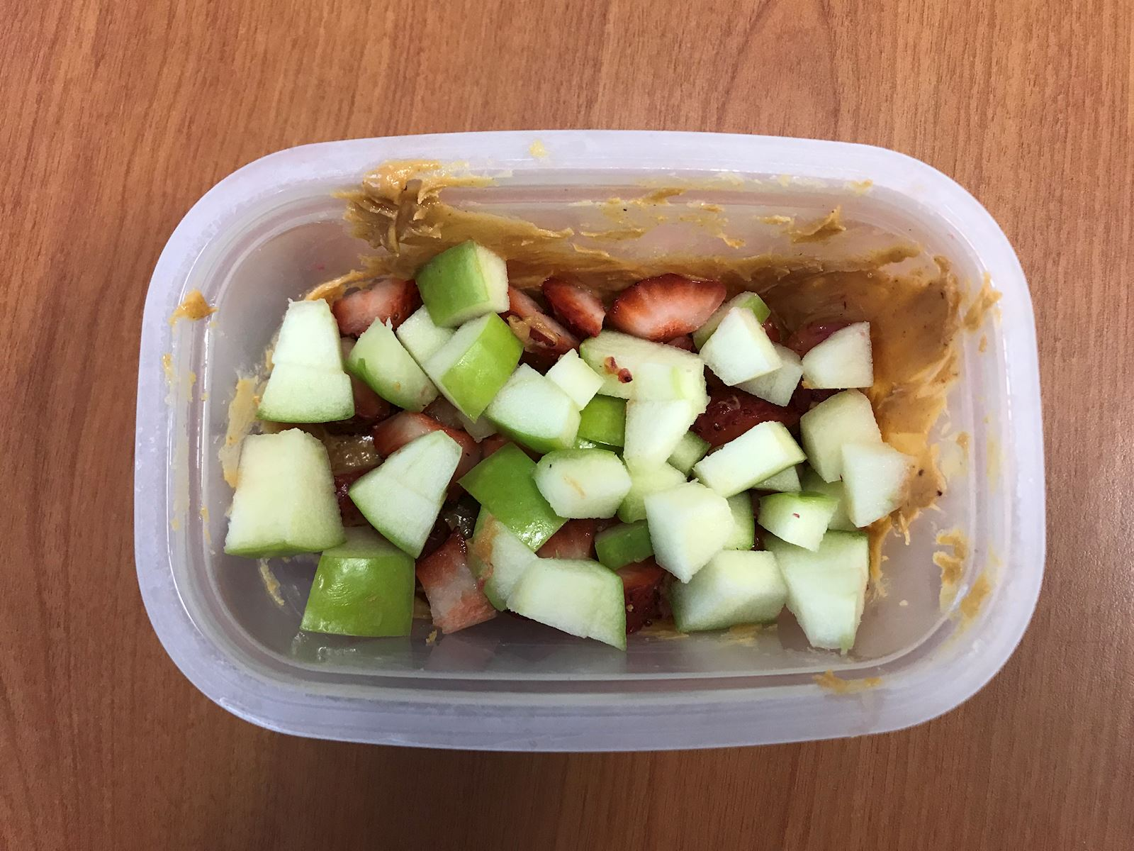 apples and strawberries on peanut butter