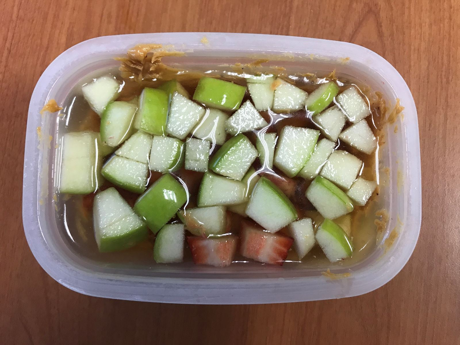 apples and strawberries in tupperware